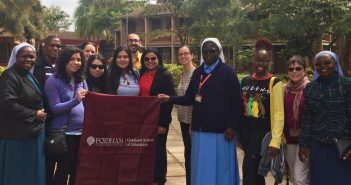 A group photo of several Kenyan nuns, GSE students, and staff
